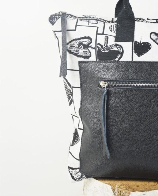 Martina cotone bianco fantasia cuori neri tasca dollaro nero dettaglio.