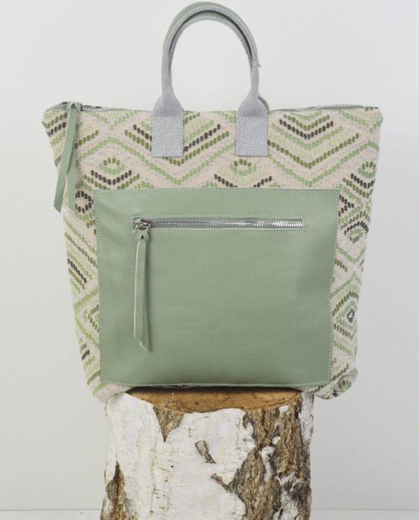 Martina cotone fantasia rombi tasca dollaro verde primo piano.